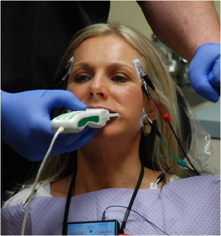 Woman receiving digital occlusal analysis with images on computer